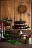 Chocolate cream with ganache on an antique cake stand