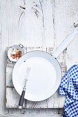 Empty frying pan on white wooden surface