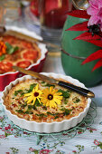 Tart decorated with marigold blossoms