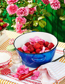 Fresh strawberries with rose petals