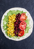 Wraps with avocado, sweetcorn, kidney beans and tomatoes