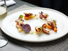 Grilled octopus with sauce and vegetables