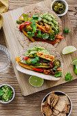 Vegeterian fajitas with guacamole, halloumi and coriander