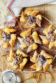 Puff pastries with almond and apple filling in star shapes (Christmas)