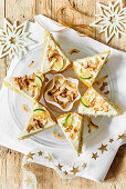 Lime cake with coconut shavings arranged in a star shape (Christmas)