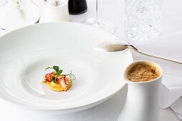 Raviolo with lobster and lobster bisque