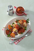 Turkey-pumpkin skewers with mango-tomato sauce