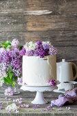 Vanilla buttercream cake with lilacs