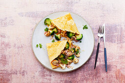 Stuffed pancakes with ham, mushrooms, broccoli and cheese