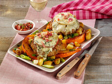 Meatballs au gratin with cheese on pumpkin-potatoes-vegetables