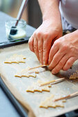Prepare Christmas tree biscuits on a stick