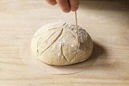 Prepare country bread Cut pattern in dough piece