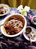 Caramel, pecan and date pudding