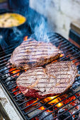 Beef steaks on a grill