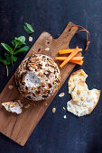 Goat's cheese ball with sardines and mint