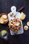 Gouda cheese ball with cumin and dried fruits