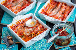 Cannelloni with quark, spinach and dried tomatoes, baked in tomato sauce