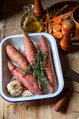 Ingredients for making roasted sweet potatoes with garlic, rosemary and olive oil