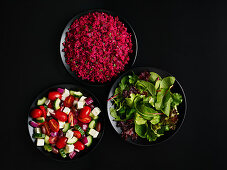Three different salads in bowls