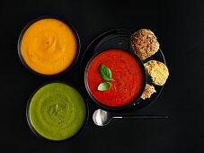 Three different colored cream soups