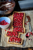 Tart with jam, chocolate ganache and pomegranate