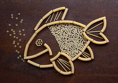 A fish made from raw pasta shapes