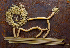 A lion made from raw pasta shapes