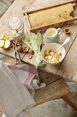 Oat porridge with apple, honey and nuts on a rustic wooden table