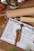 Handwritten recipe card, pastry wheel, and rolling pin