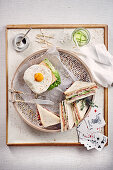 Classic club sandwich and a sandwich with fried egg
