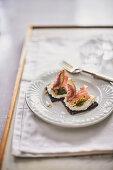 Pumpernickel with walnut mascarpone, raw ham and figs