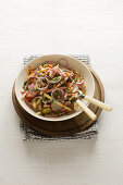 Swiss sausage salad with cheese and onions