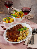 Roast beef in Vin Santo with fried gnocchi