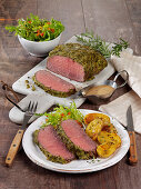 Roast beef with a herb mustard crust and rosemary potatoes