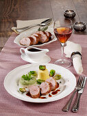 Roast pork loin with cabbage ring and potato pudding