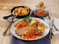 Vegetarian nut roast with carrots and fried potatoes