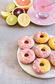 Blood orange glazed baked almond donuts decorated with heart shaped sprinkles