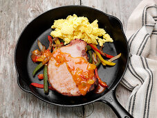 Smoked pork chop, bell peppers and fajita style sauce with scrambled eggs