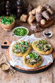Jerusalem artichoke pizzetas with rocket pesto