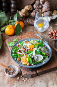 Jerusalem artichoke salad with tangerines and hazelnuts