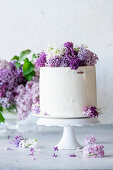 Buttercream cake with lilacs