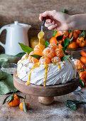 Tangerine curd Pavlova