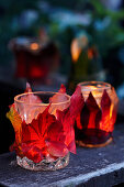 DIY lanterns decorated with autumn leaves