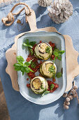 Winter eggplant timbale with ricotta cream and pesto