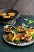 Two kinds of potato patties with vegetables, mince and Indian spices