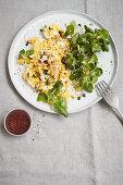Vegan cauliflower and almond 'scrambled eggs' with green salad