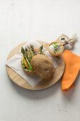 Asparagus burger with ham, cheddar and sour cream