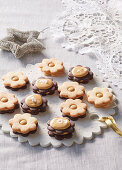 Linzer Christmas cookies with caramel cream and salt