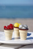Currants, yellow watermelon, and dragon fruit, served in ice cream cones