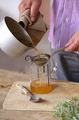 Making vermouth (as a spring cure): Pour white wine over the herbs